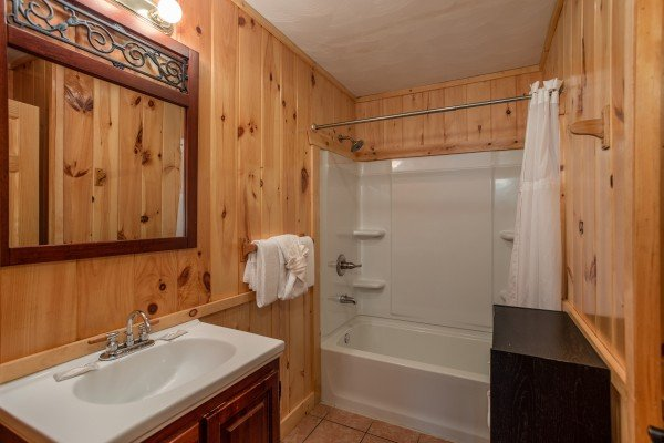 Bathroom with a tub and shower at Around the Bend, a 3 bedroom cabin rental located in Pigeon Forge