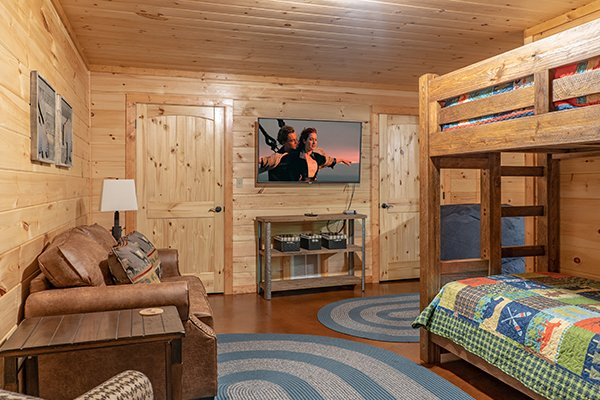 Bunk room with TV at Relaxation Ridge, a 2 bedroom cabin rental located in Pigeon Forge