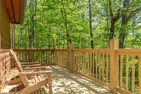 Wooded deck views at Relaxation Ridge, a 2 bedroom cabin rental located in Pigeon Forge
