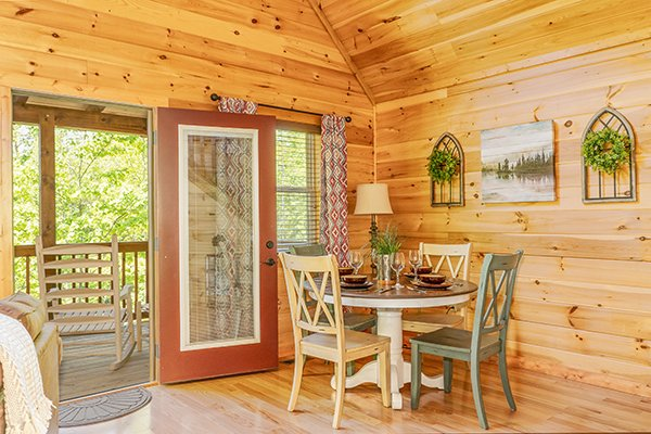 Dining space for four at Relaxation Ridge, a 2 bedroom cabin rental located in Pigeon Forge