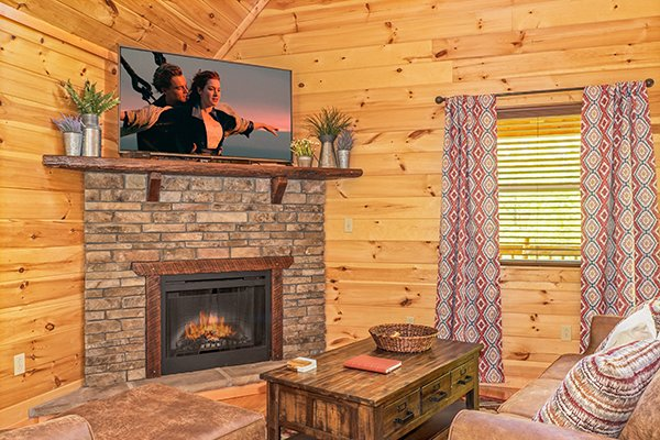 Fireplace & TV in the living room at Relaxation Ridge, a 2 bedroom cabin rental located in Pigeon Forge