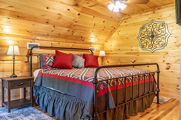 Bed in the first bedroom at Relaxation Ridge, a 2 bedroom cabin rental located in Pigeon Forge