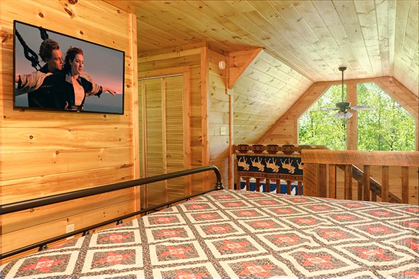 Loft bedroom space with TV at Relaxation Ridge, a 2 bedroom cabin rental located in Pigeon Forge