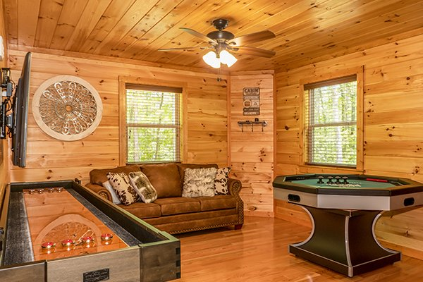 Shuffleboard and bumper pool at Relaxation Ridge, a 2 bedroom cabin rental located in Pigeon Forge