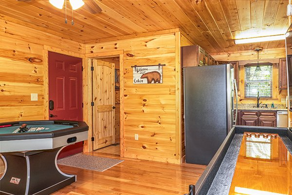 Game tables and kitchen at Relaxation Ridge, a 2 bedroom cabin rental located in Pigeon Forge