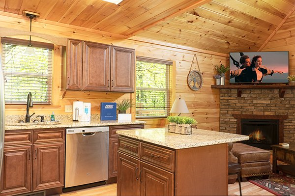 Kitchen with stainless appliances and granite at Relaxation Ridge, a 2 bedroom cabin rental located in Pigeon Forge