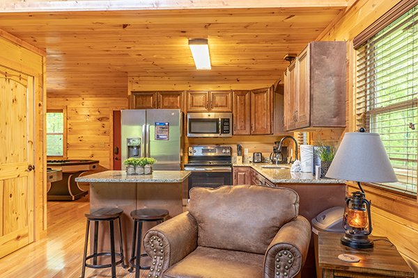 Living room and kitchen at Relaxation Ridge, a 2 bedroom cabin rental located in Pigeon Forge