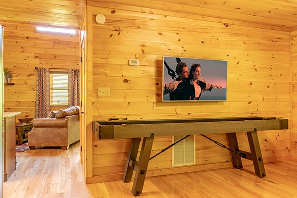 Shuffleboard game at Relaxation Ridge, a 2 bedroom cabin rental located in Pigeon Forge