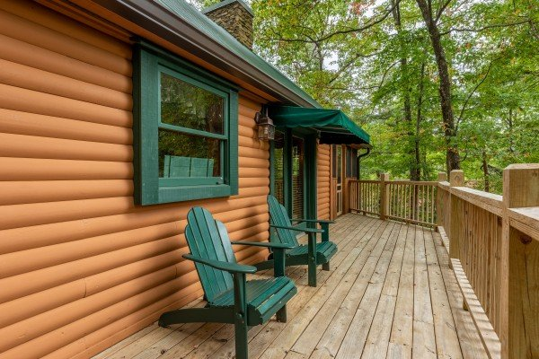 Adirondack chairs on a deck at Yes, Deer, a 2 bedroom cabin rental located in Pigeon Forge