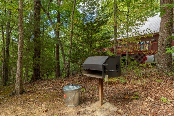 Charcoal grill in the yard at Yes, Deer, a 2 bedroom cabin rental located in Pigeon Forge