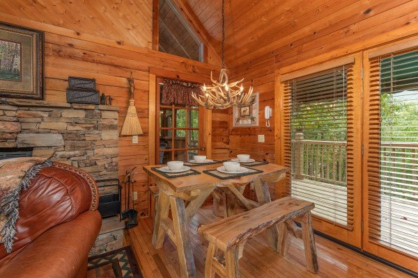 Dining space for four at Yes, Deer, a 2 bedroom cabin rental located in Pigeon Forge
