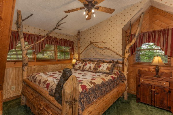 Bedroom with unique tree bed at Yes, Deer, a 2 bedroom cabin rental located in Pigeon Forge
