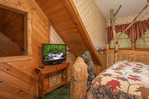 TV in a bedroom at Yes, Deer, a 2 bedroom cabin rental located in Pigeon Forge