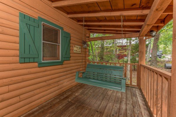 Porch swing at Yes, Deer, a 2 bedroom cabin rental located in Pigeon Forge