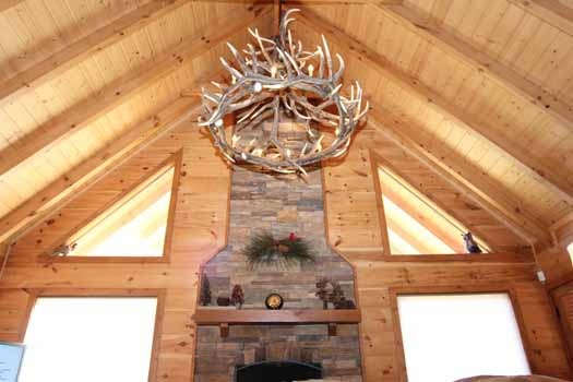 anter chandelier hanging in the living room at cedar creeks a 2 bedroom cabin rental located in douglas lake