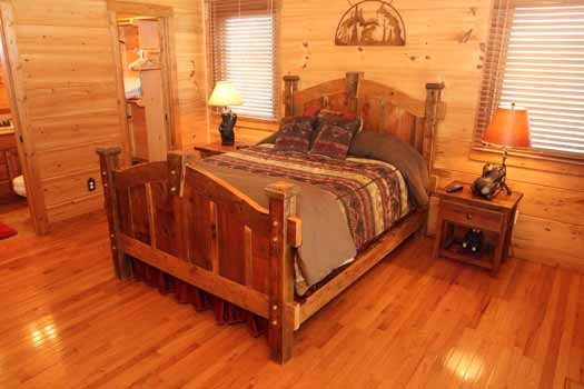 king sized bed with night stands at cedar creeks a 2 bedroom cabin rental located in douglas lake