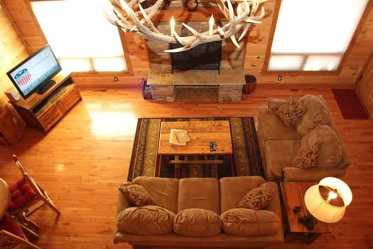 view of living room from loft at cedar creeks a 2 bedroom cabin rental located in douglas lake