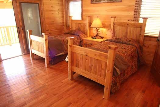 patio access from bedroom at cedar creeks a 2 bedroom cabin rental located in douglas lake