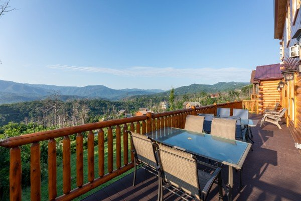 Deck dining area and the mountain view at Splash Mountain Lodge, a 4 bedroom cabin rental located in Gatlinburg
