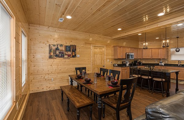 Dining table for six and counter seating for three at Splash Mountain Lodge a 4 bedroom cabin rental located in Gatlinburg