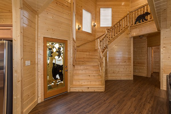 Foyer and staircase at Splash Mountain Lodge a 4 bedroom cabin rental located in Gatlinburg