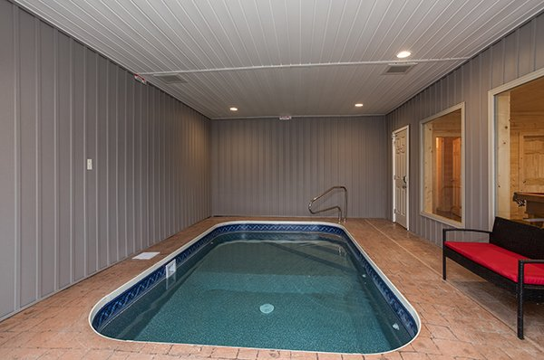 Indoor pool and bench at Splash Mountain Lodge a 4 bedroom cabin rental located in Gatlinburg