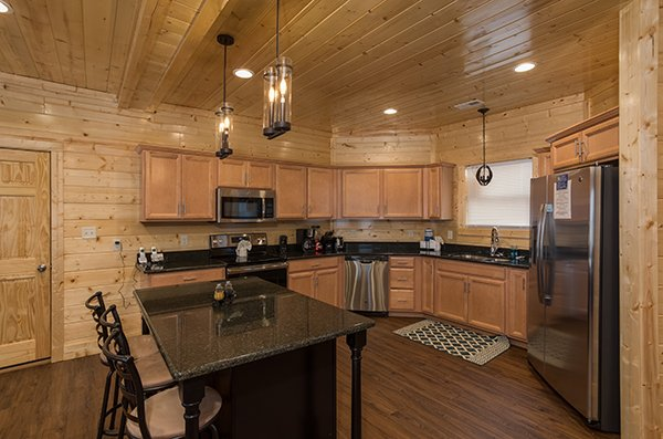 Center island in the kitchen at Splash Mountain Lodge a 4 bedroom cabin rental located in Gatlinburg