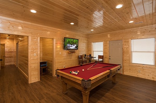 Pool table and TV at Splash Mountain Lodge a 4 bedroom cabin rental located in Gatlinburg