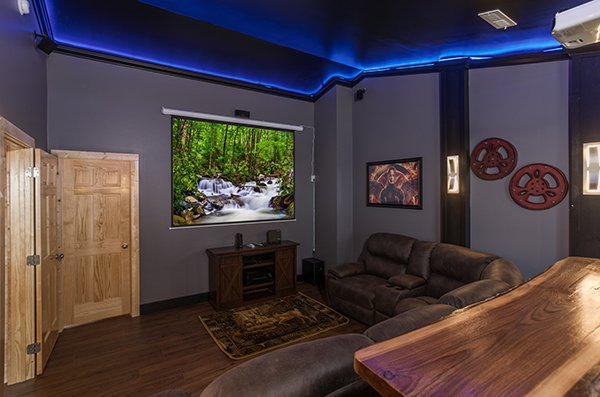 Projection theater screen at Splash Mountain Lodge a 4 bedroom cabin rental located in Gatlinburg