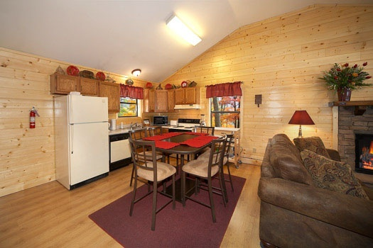 kitchen and dining area at raccoon's rest a 2 bedroom cabin rental located in pigeon forge