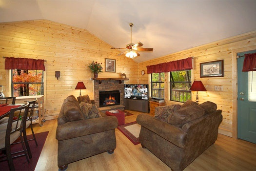 living room with fireplace at raccoon's rest a 2 bedroom cabin rental located in pigeon forge