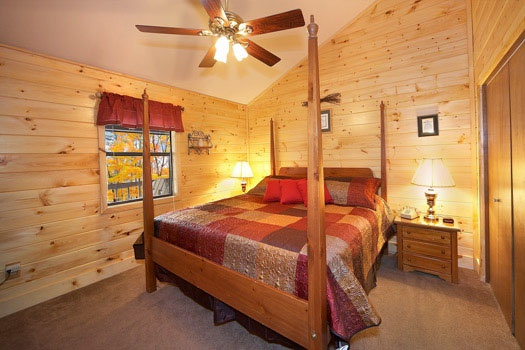 main level king bedroom at raccoon's rest a 2 bedroom cabin rental located in pigeon forge