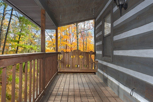 Rear deck at Raccoon's Rest, a 2 bedroom cabin rental located in Pigeon Forge