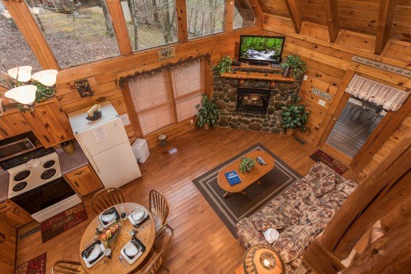 Looking down onto the main floor from upstairs at Gettin' Lucky, a 1-bedroom cabin rental located in Gatlinburg