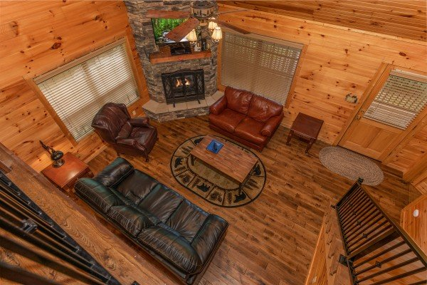 Looking down into the living room at Time to Pause, a 2 bedroom cabin rental located in Pigeon Forge