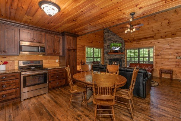 Dining able for five in the kitchen at Time to Pause, a 2 bedroom cabin rental located in Pigeon Forge