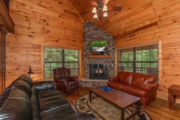 Fireplace and TV in the living room at Time to Pause, a 2 bedroom cabin rental located in Pigeon Forge