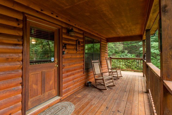 Covered front porch with rocking chairs at Time to Pause, a 2 bedroom cabin rental located in Pigeon Forge
