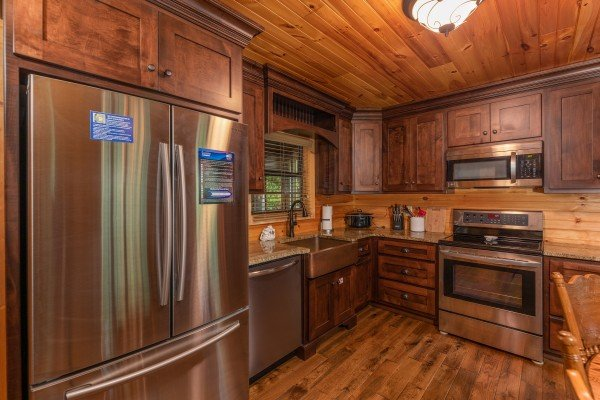 Kitchen with stainless appliances at Time to Pause, a 2 bedroom cabin rental located in Pigeon Forge
