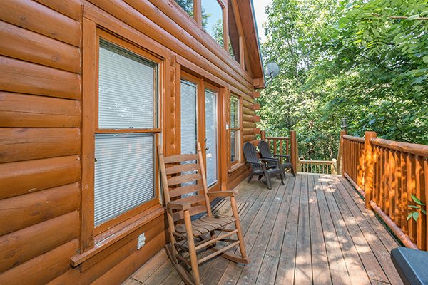 Deck with rocking chair and two Adirondack chairs at My Blue Heaven, a 1 bedroom cabin rental located in Gatlinburg