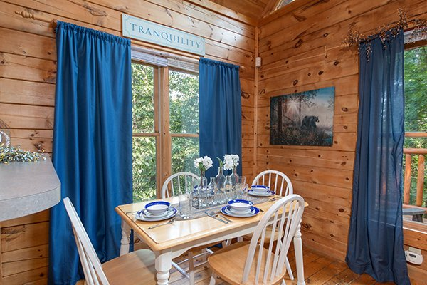 Dining table for four at My Blue Heaven, a 1 bedroom cabin rental located in Gatlinburg