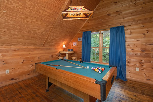 Game loft with a pool table at My Blue Heaven, a 1 bedroom cabin rental located in Gatlinburg