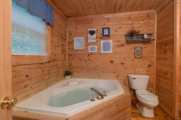 Jacuzzi in the corner of the bathroom at My Blue Heaven, a 1 bedroom cabin rental located in Gatlinburg