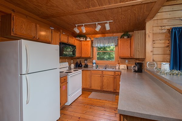 Kitchen with white appliances at My Blue Heaven, a 1 bedroom cabin rental located in Gatlinburg