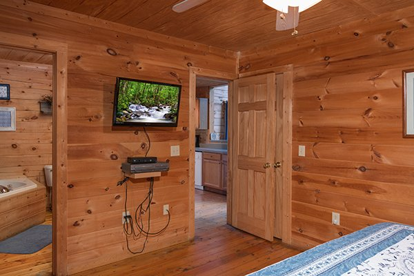 Wall mounted TV in the bedroom at My Blue Heaven, a 1 bedroom cabin rental located in Gatlinburg