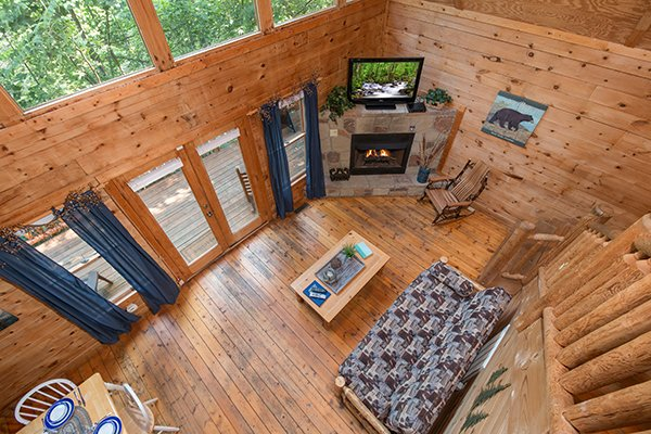 Looking down to the living room from the upper floor at My Blue Heaven, a 1 bedroom cabin rental located in Gatlinburg