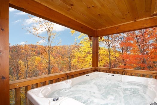 covered hot tub at settlin' inn a 3 bedroom cabin rental located in gatlinburg
