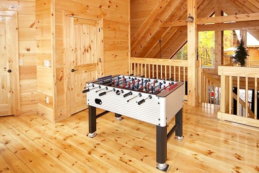 game room with foosball table at settlin' inn a 3 bedroom cabin rental located in gatlinburg