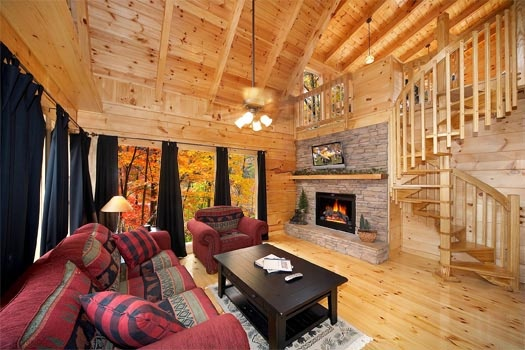 living room with fireplace at settlin' inn a 3 bedroom cabin rental located in gatlinburg