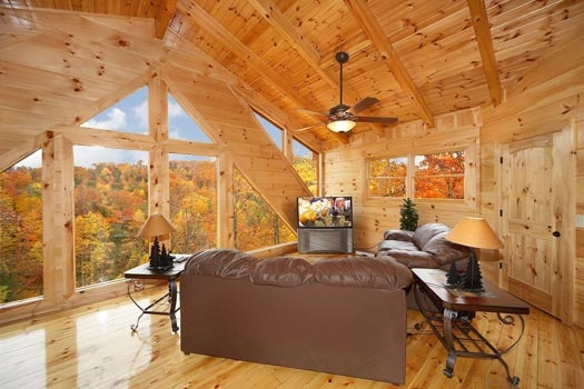 lofted area with sleeper sofa at settlin' inn a 3 bedroom cabin rental located in gatlinburg